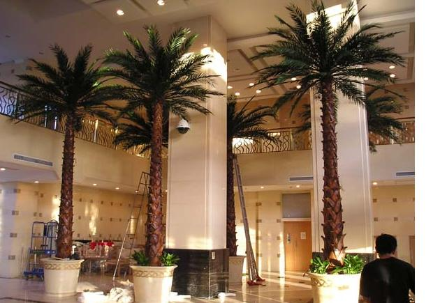 image of 3 fabricated palm trees inside a building