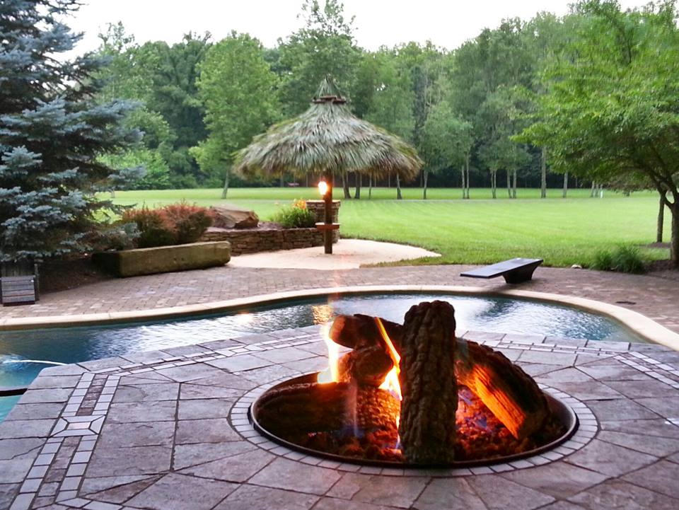 Image of a Tiki Hut by a fire pit