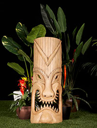 image of 4 unique Tiki Poles of varying height depicting Tiki Gods